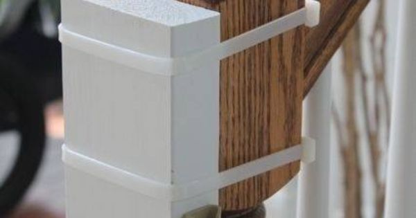 Instead of nailing a baby gate into a non-square banister, use cable ties t