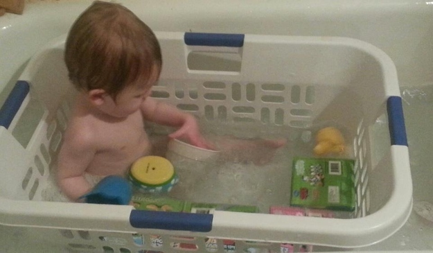 Using a laundry basket in the tub can be a great way to keep a young toddle